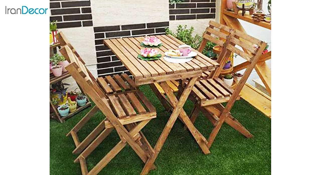 عکس چیدمان ست 4 نفره میز و صندلی تاشو چوبی مدل مزرعه